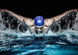 35435608 - muscular young man in blue cap in swimming pool