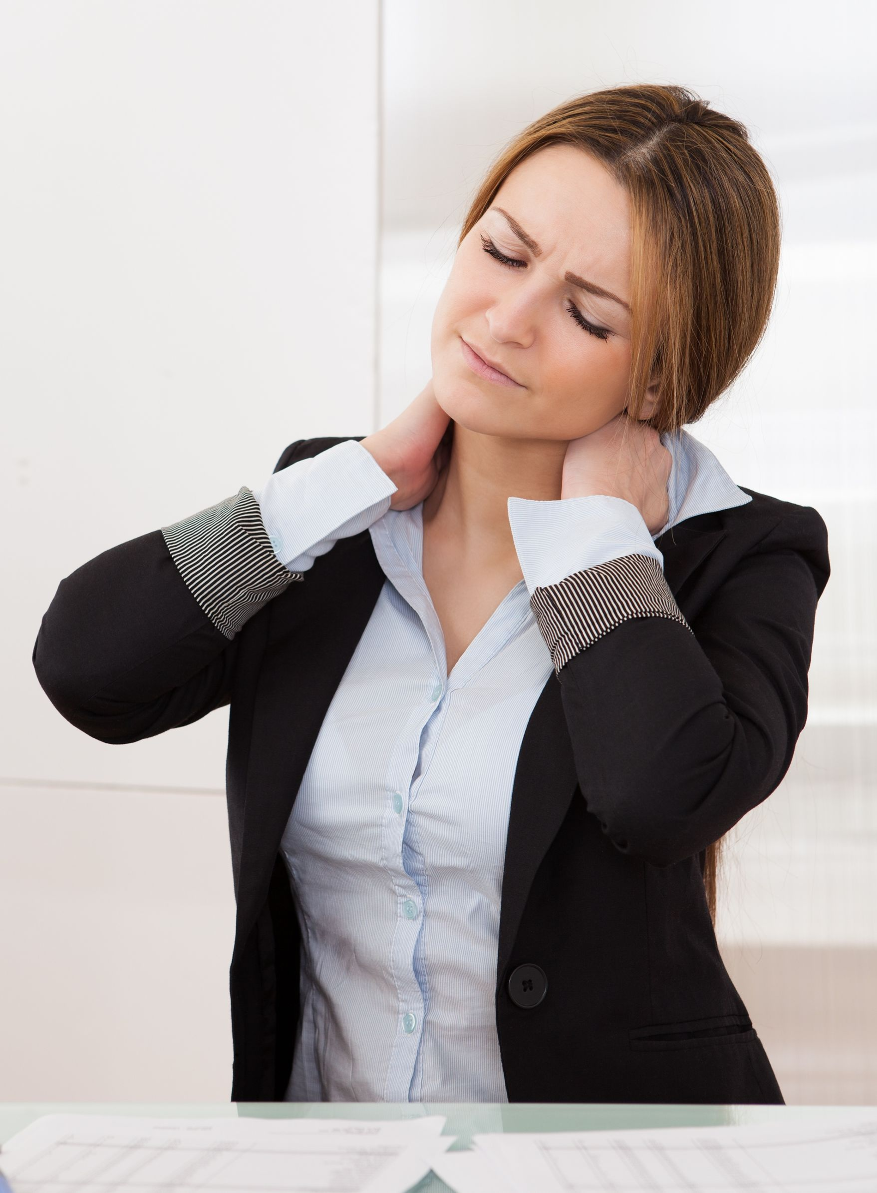 19168037 - young attractive businesswoman suffer from neck pain
